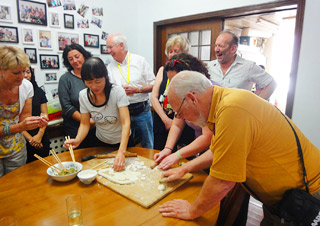 Our clients learning to make dumpling at a local family house