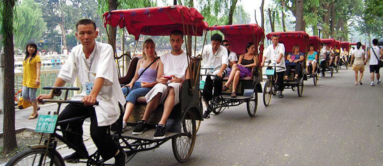 Experience a rickshaw tour through Hutongs
