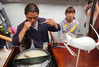 Folk artist is making sugar figure