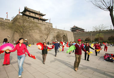 Locals are dancing in the City Wall Park