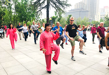 Our group learning Tai Chi with locals