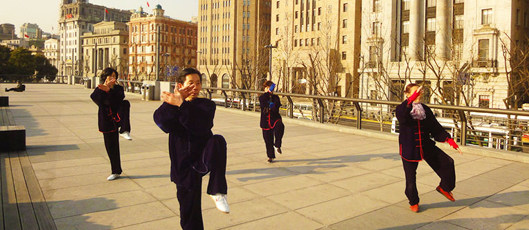 Local people playing Tai Chi at the Bund area