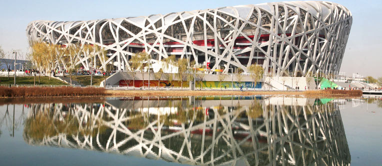Have a photo stop at the Bird's Nest and view its distinctive appearance