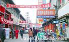 In the street, you can see various billboards with names of shops on, Taiyuan City.