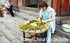 A young woman was doing the housework outside the house, Qingyan Ancient Town, Guizhou.