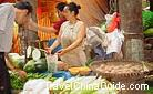 A glance at common people''s life in China - vegetables are usually bought from such vendors in the free market.