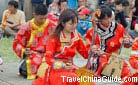 Wearing the bright ethical costumes, they are playing Mongolian horse-head fiddles for visitors.