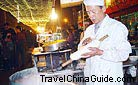 In the night market, the chef is making Shaved Noodles for sale.