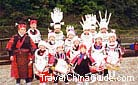 Miao mothers and kids dress in traditional costumes to celebrate their festival, Guizhou