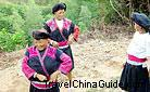 The Yao women like coiling their long hair on the head and wearing big earrings.