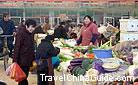 In China, the open-air food markets like this one are often seen.