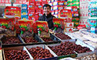 This is a market stall selling Chinese dates and many other local products.