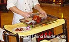 A well-roasted Beijing duck could be cut into 80-100 slices by a skillful chef.