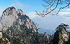 The azure sky and the floating white clouds illuminate the beauty of Mt. Huangshan.
