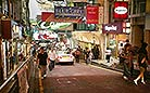 Hong Kong's night life is busy and exciting. People strolling on the streets are looking for a place to enjoy themselves.