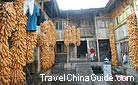 A local residence with hanging corns shows the typical Tunpu Culture of Jichang Village.