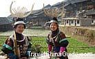 Beautiful Miao girls wearing their traditional costumes and delicate silver headgears, Qingman Miao Village, Kaili, Guizhou.