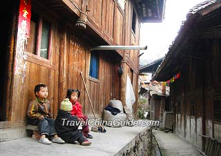 Miao minority children and their wooden houses, Guizhou