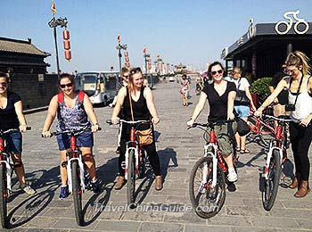 Our clients riding bicycle on Xi'an City Wall