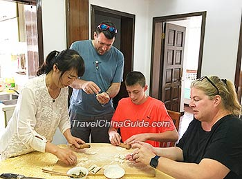 Our clients learning to make dumplings in Xi'an family visit