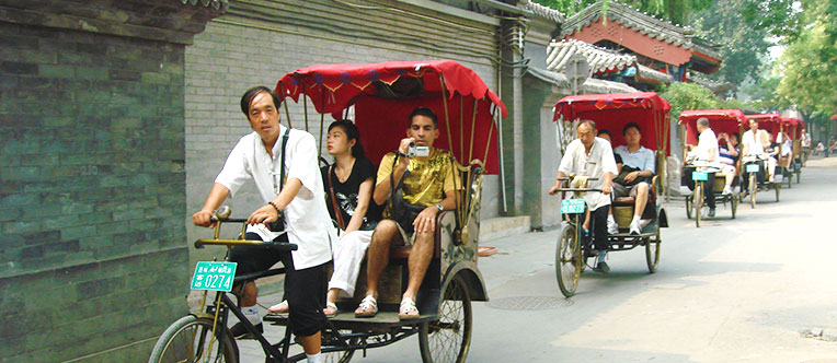 Travel through the Hutongs by rickshaw and catch a glimpse of old Beijingers' life