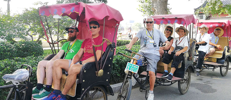 Experience a rickshaw tour through Hutong Alleys