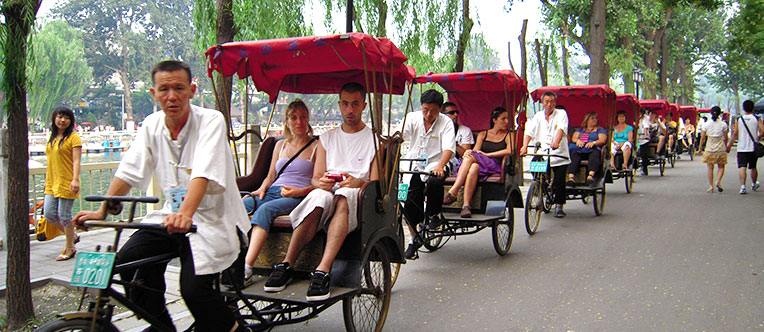Experience a rickshaw tour through Hutongs and feel the real old Beijing