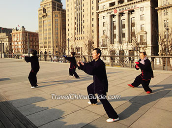 Local people playing Tai Chi at the Bund
