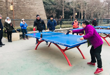 Play table tennis with local people