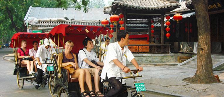 Experience a rickshaw tour through Hutong alleys