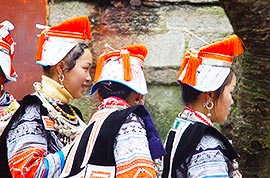 Gejia girls in their traditional costumes