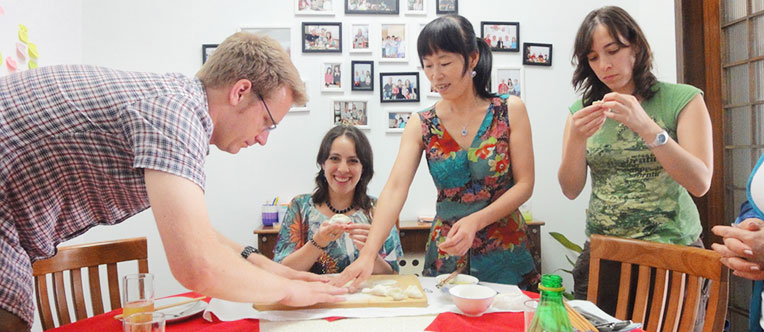 Our guests are learning to make dumplings at a local home