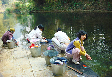 Local people doing laundry by the river
