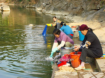 Local people doing the laundry by the river
