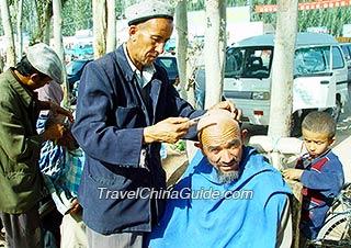 Barbering on the street, Kashgar